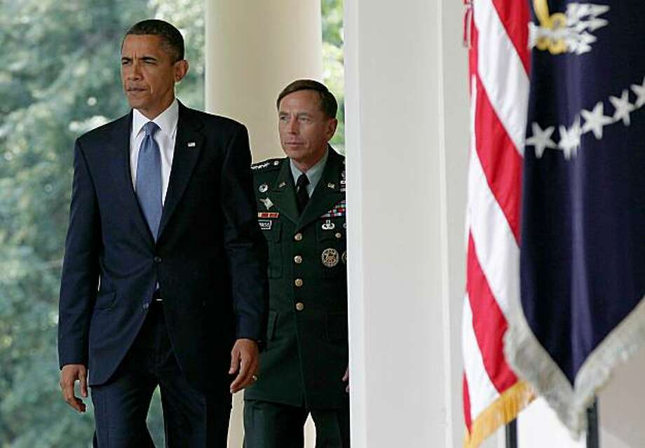 WASHINGTON - JUNE 23:  U.S. President Barack Obama walks with Gen. David Petraeus, who will succeed Gen. Stanley McChrystal as commander of U.S. forces in Afghanistan to make a  statement in the Rose Garden of the White House June 23, 2010 in Washington,DC. Earlier in the day U.S. Army General Stanley McChrystal was relieved as top commander of the U.S. Forces in Afghanistan by Obama due to disparaging comments he made of members of the Obama administration which were published in Rolling Stone magazine. Photo: Win McNamee, Getty Images