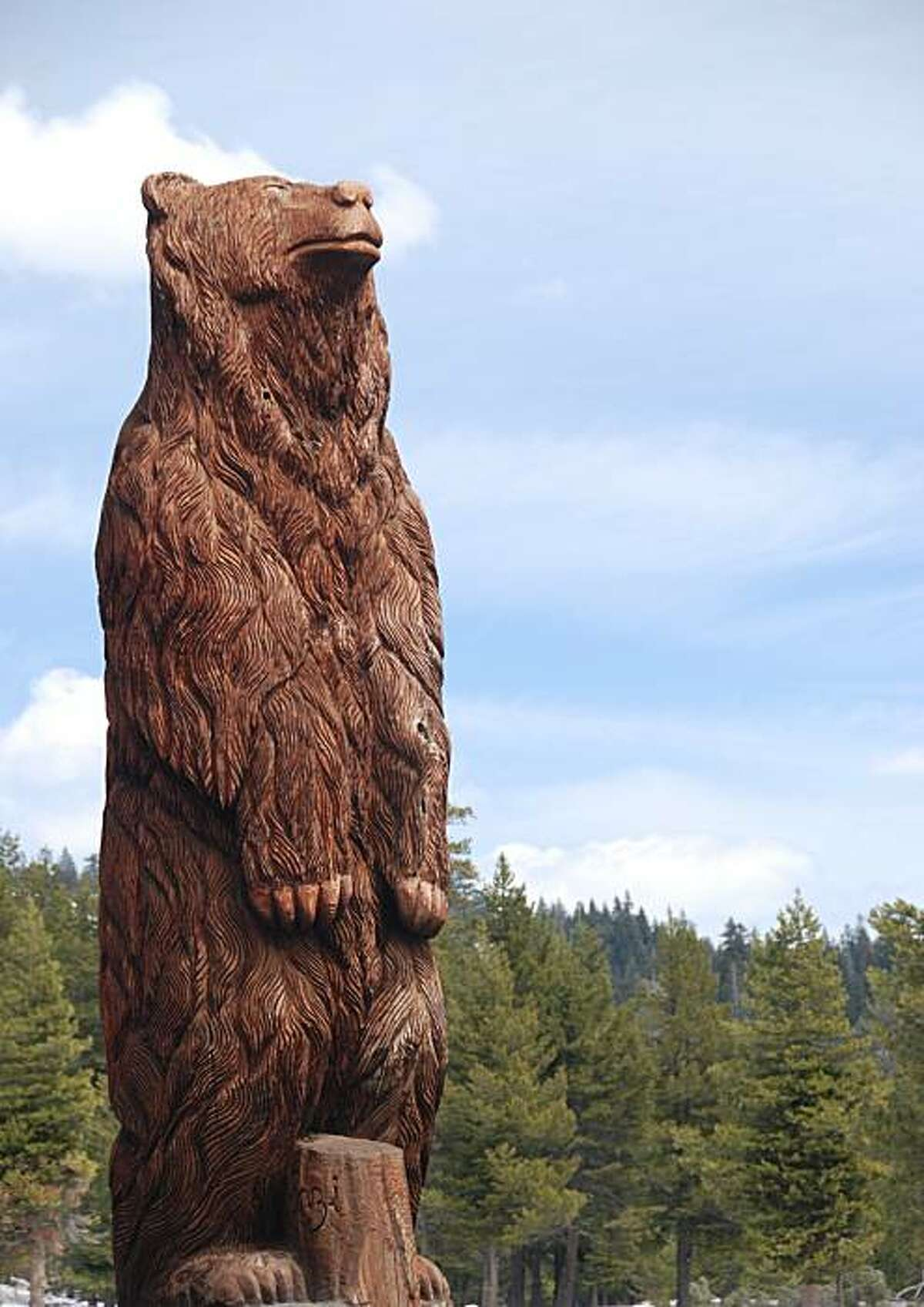 Huge carved bear at the entrance to Bear Valley.