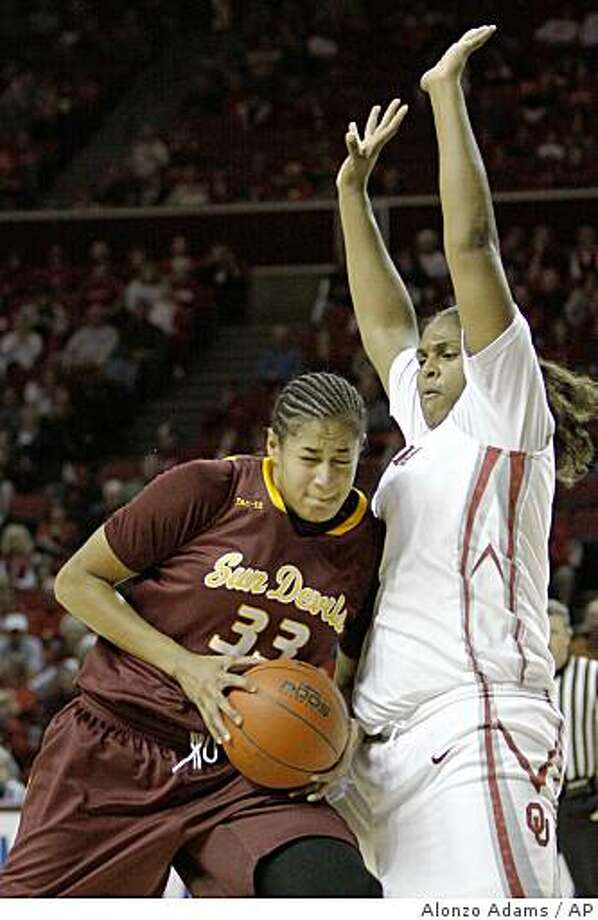 Arizona State's Sybil Dosty, left, runs into Oklahoma's Courtney Paris, right, on her way to the basket during the first half of an NCAA college women's basketball game in Norman, Okla. on Friday, Nov. 21, 2008.  (AP Photo/Alonzo Adams) Photo: Alonzo Adams, AP
