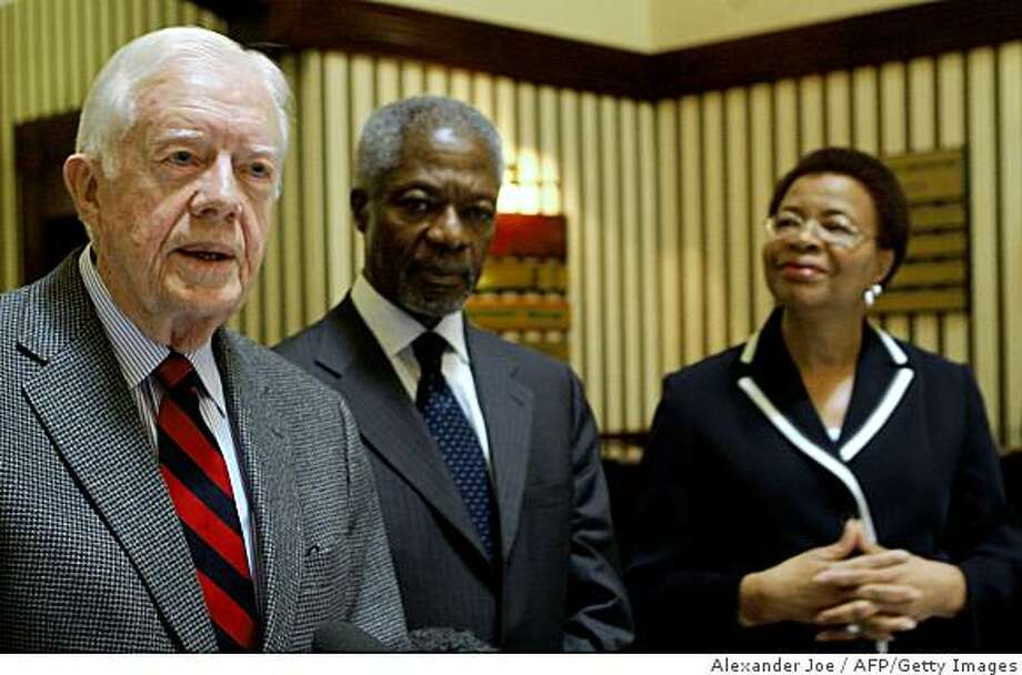 """Former US President Jimmy Carter (L), former United Nations Secretary-General Kofi Annan (C)and Mrs Graca Machel of Mozambique, the three elders who were expected to go to Zimbabwe have been refused visas and cancelled their trip to Harare. They told a press conference in Johannesburg on November 22, 2008. Mr Annan said  """" We need no red carpet treatment from the government of Zimbabwe"""" """"We seek no permission other permission to help the poor and the desperate"""".   AFP PHOTO / ALEXANDER JOE (Photo credit should read ALEXANDER JOE/AFP/Getty Images) Photo: Alexander Joe, AFP/Getty Images"""