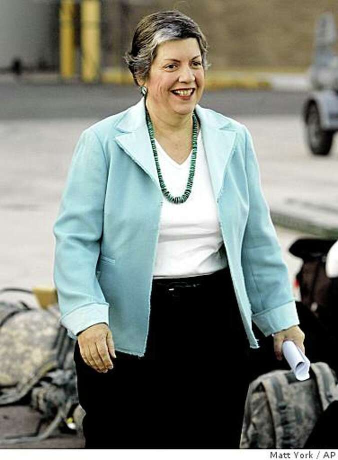 Arizona Gov. Janet Napolitano arrives at the Arizona Air Guard's 161st refueling Wing at Sky Harbor International Airport early Friday, Nov. 21, 2008 in Phoenix to greet members of the 996th Area Support Medical Company arriving home after serving one year in Iraq. Napolitano is President-elect Barack Obama's top choice to run the Department of Homeland Security. (AP Photo/Matt York) Photo: Matt York, AP