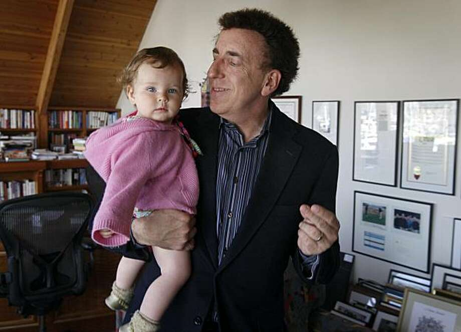 Dr. Dean Ornish entertains his 11-month-old daughter Jasmine at his office in Sausalito, Calif., on Thursday, June 3, 2010. Photo: Paul Chinn, The Chronicle