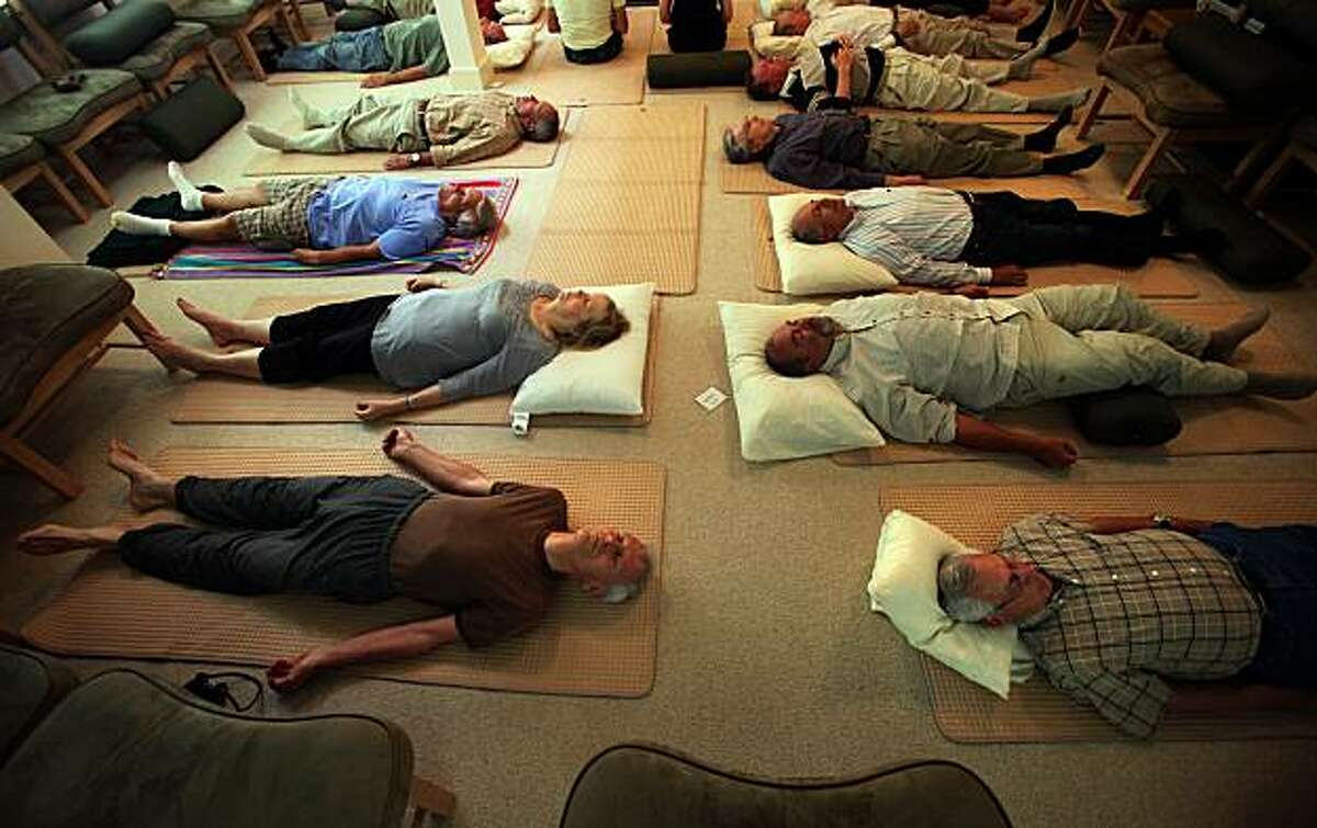 Patients of the Preventative Medicine Research Institute out of Sausalito, Calif., having a yoga session on Thursday, June 3, 2010. Health/lifestyle guru Dean Ornish has been studying the gains of simple lifestyle changes on all types of cancer and cardiovascular disease for decades.