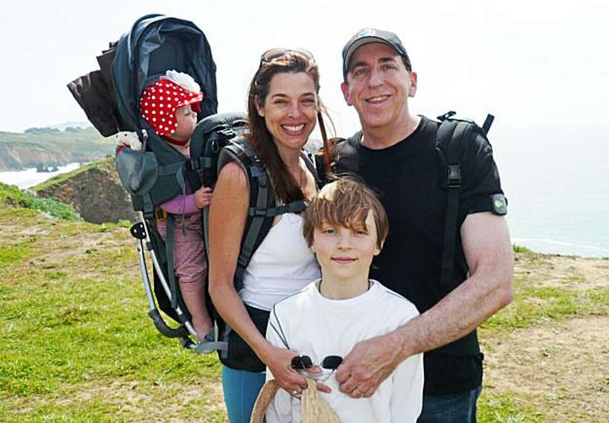 Dean and wife Anne Ornish with 1-year-old Jasmine and 9-year-old Lucas, hiking in the Marin Headlands.