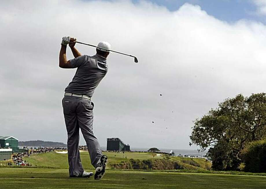 Dustin Johnson tees off on the 6th hole during 3rd round action of the 110th US Open golf tournament at Pebble Beach Golf Links Saturday June 19, 2010 Photo: Lance Iversen, The Chronicle