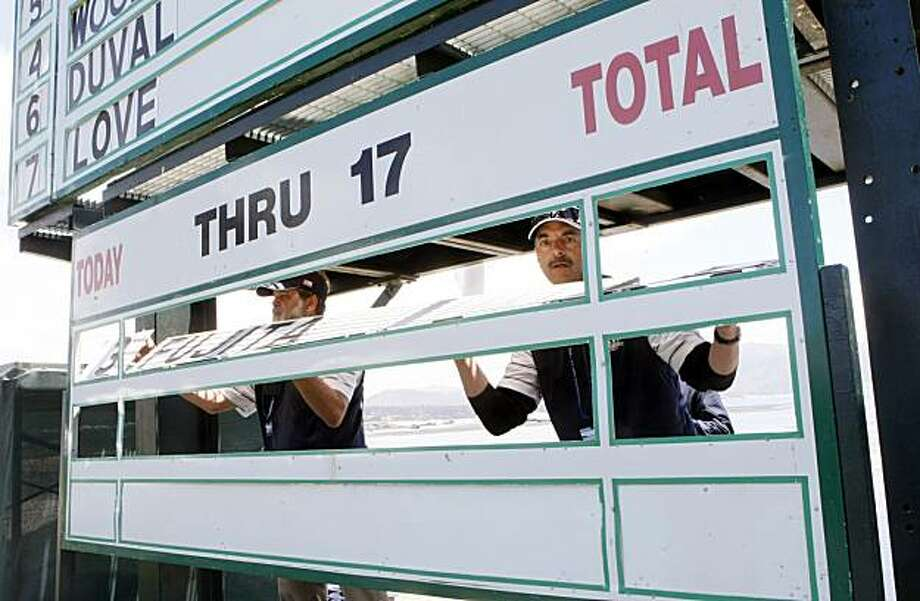 Scoreboard Volunteers, Michael Lloyd left and Michael Moran work on replacing golfers names on the Thru Board on the 18th green during 3rd round action of the 110th US Open golf tournament at Pebble Beach Golf links Saturday June 19, 2010 Photo: Lance Iversen, The Chronicle