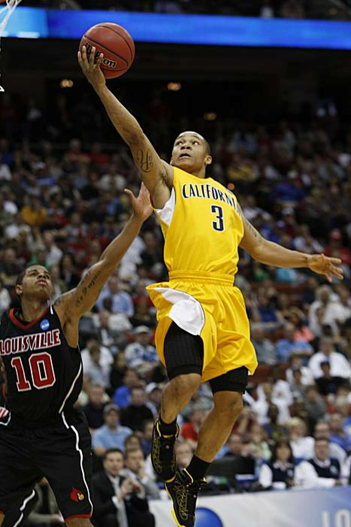 California's Jerome Randle (3) goes for the basket as Louisville's Edgar Sosa (10) defends during an NCAA first-round college basketball game in Jacksonville, Fla., Friday, March 19, 2010.