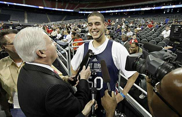 Saint Mary's Omar Samhan smiles as he is surrounded by reporters during an NCAA college basketball practice in Houston, Thursday, March 25, 2010. Saint Mary's will play Baylor in a South Regional semifinal on Friday. Photo: David J. Phillip, AP