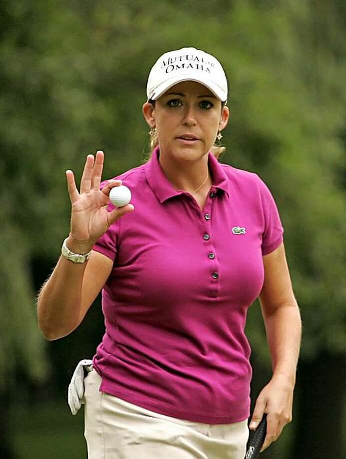PITTSFORD, NY - JUNE 26: Cristie Kerr waves to the crowd after making birdie on the fourth hole during the third round of the LPGA Championship presented by Wegmans at Locust Hill Country Club on June 26, 2010 in Pittsford, New York. Photo: Hunter Martin, Getty Images