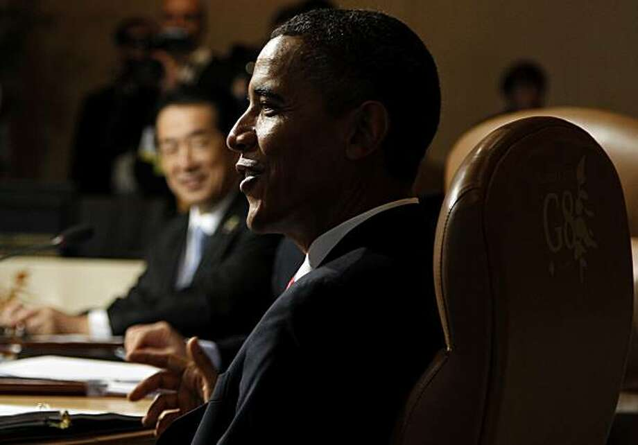 President Barack Obama of the United States and Prime Minister Naoto Kan of Japan, back left, are seen as they attend a leaders working session at the G8 Summit at Deerhurst Resort in Huntsville, Ontario, Saturday, June 26, 2010. Photo: Charles Dharapak, AP