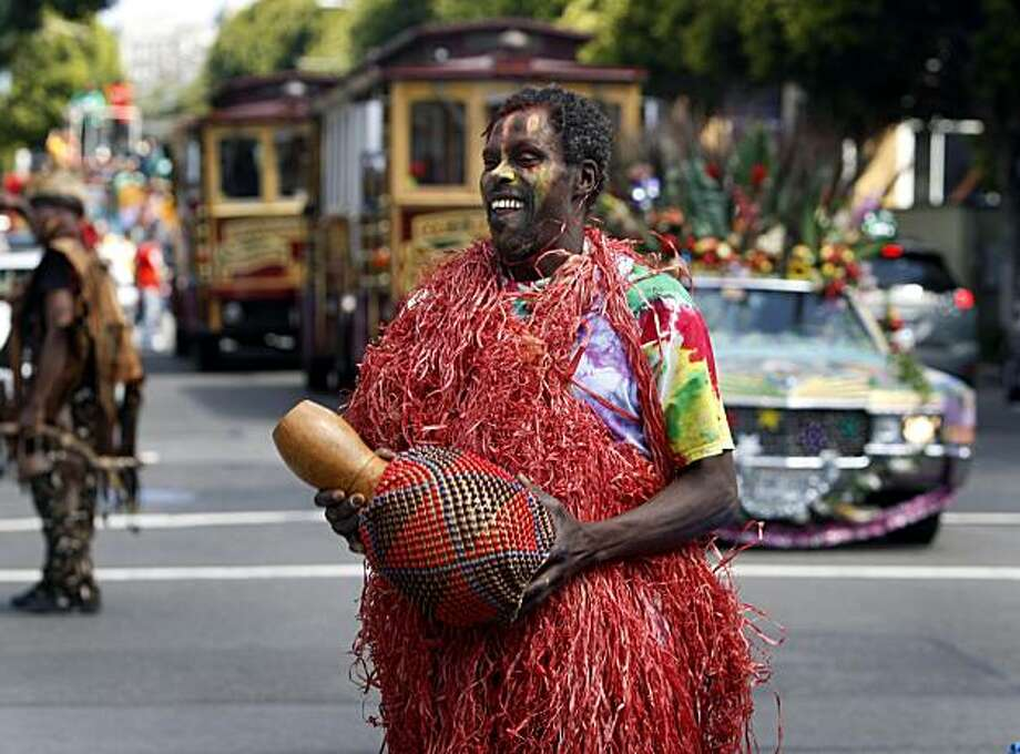 Kweku Acquaah shakes a musical instrument while marching in the Juneteenth Parade on Fillmore Street in San Francisco, Calif., on Saturday, June 19, 2010. Participants marched from Scott and Post streets to an all-day festival at Civic Center Plaza to commemorate the end of slavery in 1865. Photo: Paul Chinn, The Chronicle