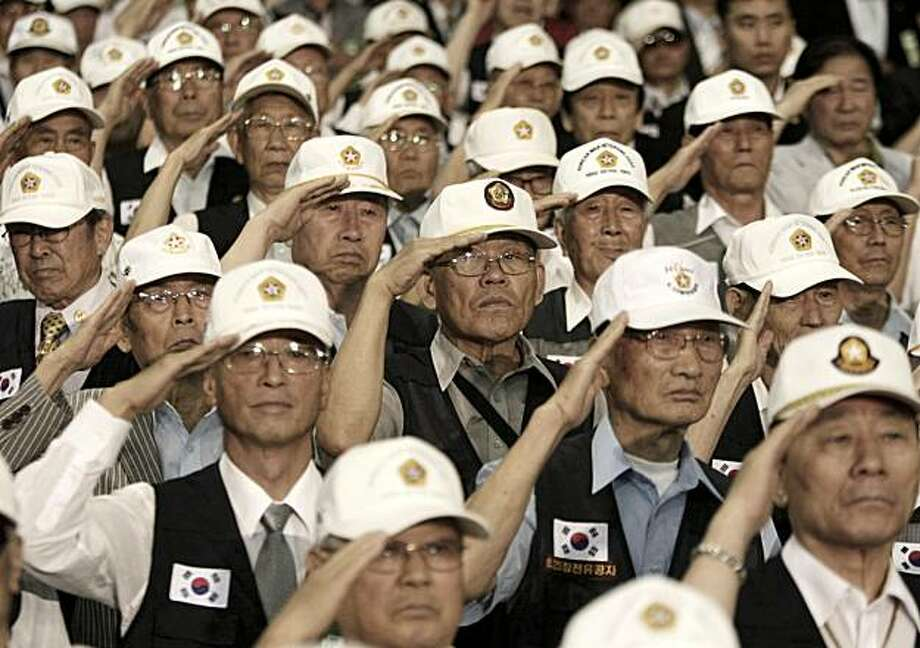 Korean War veterans salute during a ceremony to mark the 60th anniversary of the outbreak of the Korean War in Seoul, South Korea, Friday, June 25, 2010. The two Koreas commemorated the anniversary Friday of the war, promoting vastly different views of the origins of the conflict that still divides their peninsula a full six decades later. Photo: Ahn Young-joon, AP