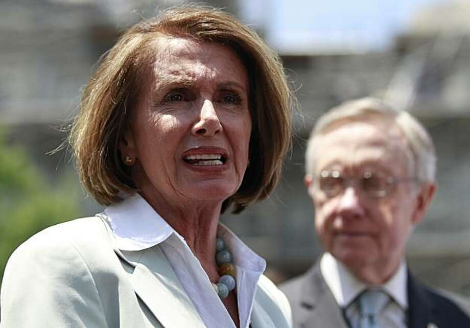 House Speaker Nancy Pelosi of Calif., accompanied by Senate Majority Leader Harry Reid of Nev. speaks to reporters outside the White House in Washington, Thursday, June 10, 2010, after they met with President Barack Obama regarding the BP Deepwater Horizon oil spill. Photo: Charles Dharapak, AP