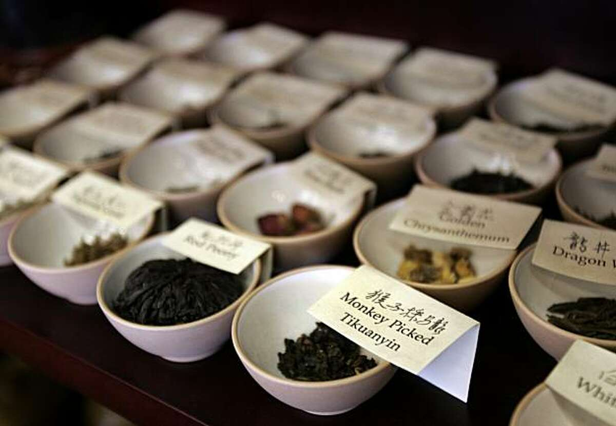 A selection of teas are arranged in finger bowls for customers to smell at the Imperial Tea Court at the Ferry Building in San Francisco.