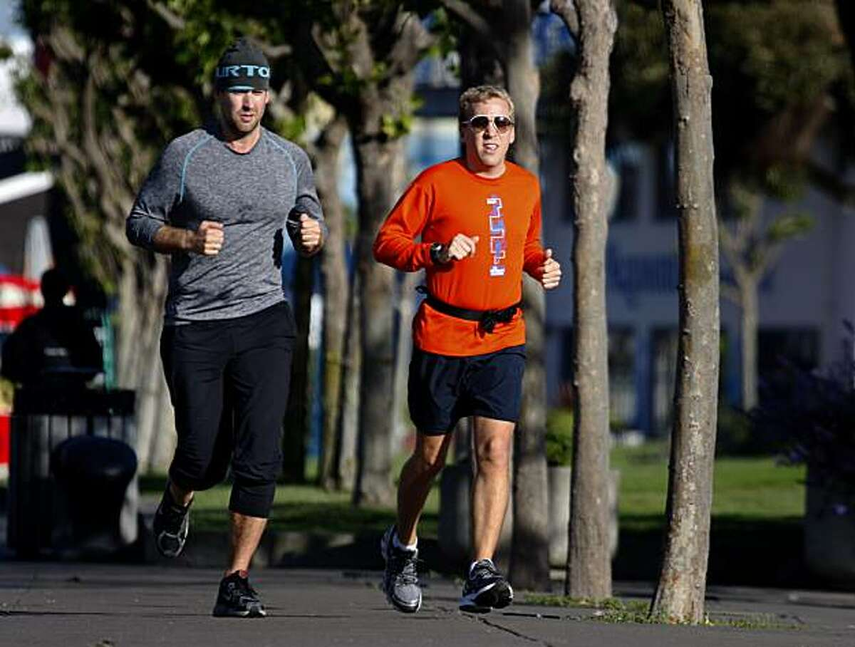 Tyler Mitchell (left) goes for a morning run on The Embarcadero with his cousin Andrew Mitchell in San Francisco, Calif., on Friday, May 7, 2010. Tyler Mitchell is the new manager of the Wilkes Bashford clothing store.