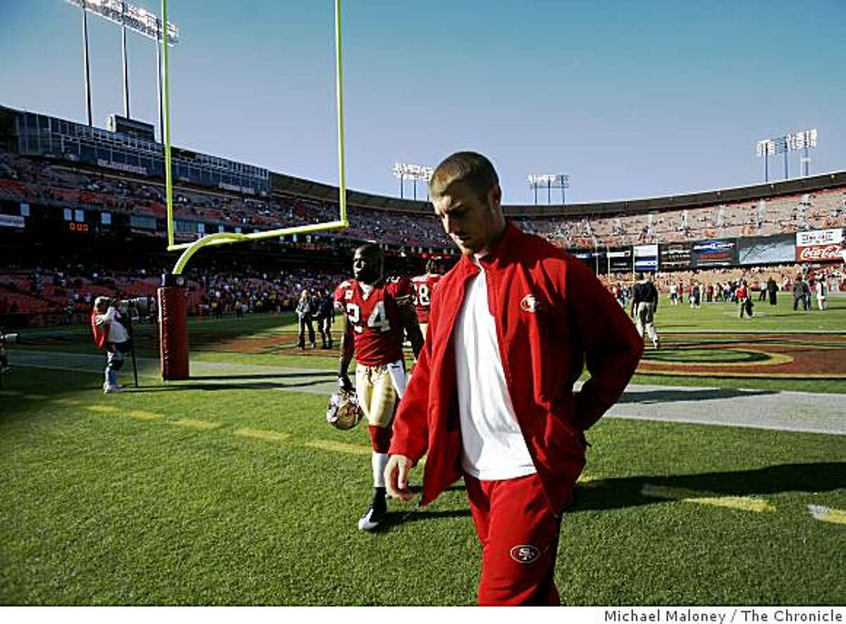 San Francisco 49ers injured quarterback Alex Smith walks off the field after the 49ers lost 30-21during a NFL game against the New England Patriots at Candlestick Park in San Francisco, Calif., on October 5, 2008.