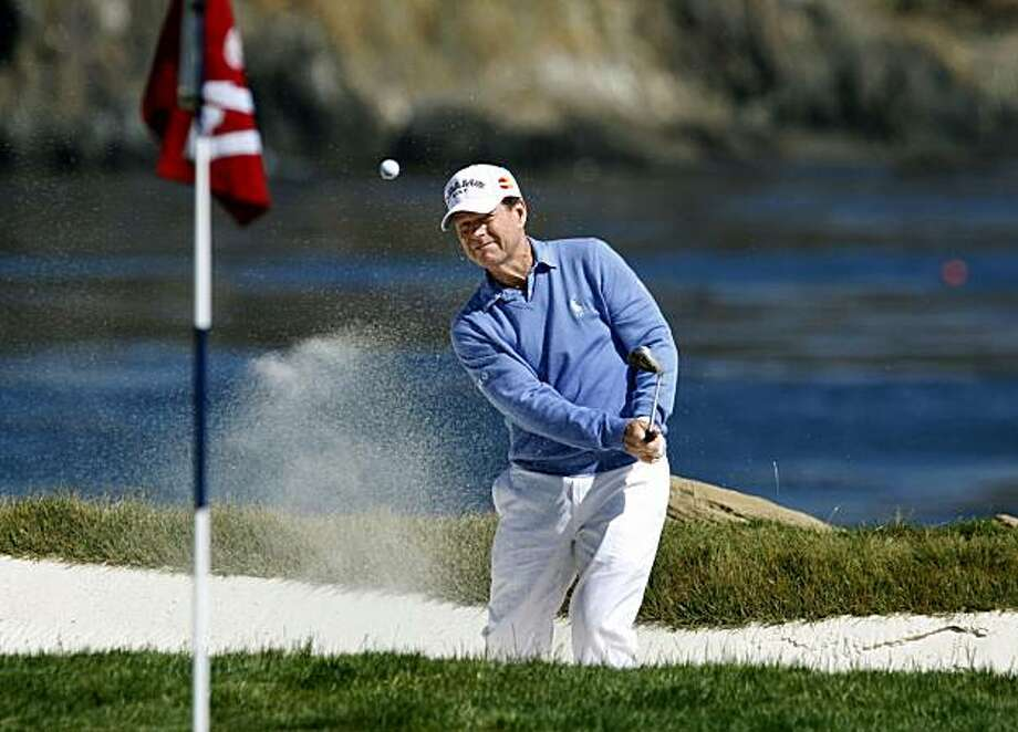 Tom Watson blasts out of the trap onto the 17th green at Pebble Beach, site of the 110th annual U.S. Open on Thursday. In 1972, Watson performed a similar shot on 17th that gave him the lead, and one hole later he was crowned champion. Photo: Lance Iversen, The Chronicle