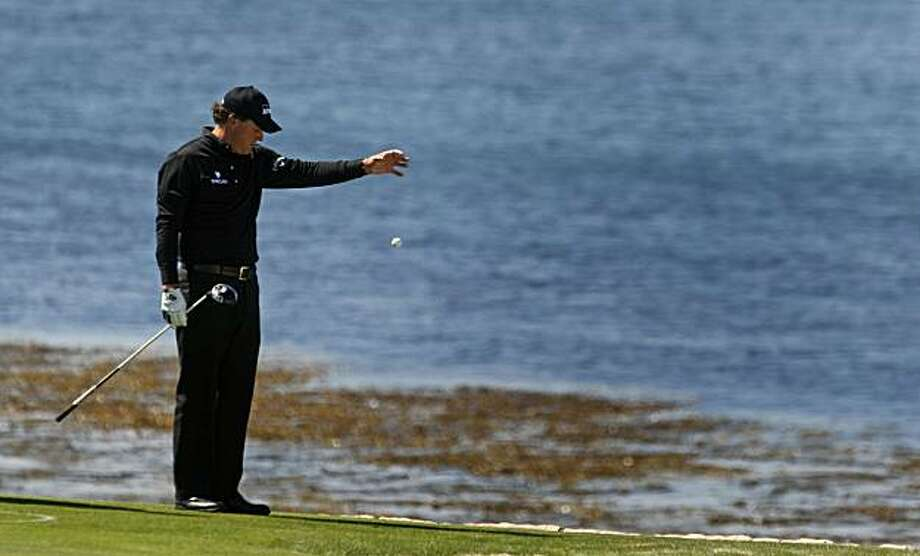 Phil Mickelson drops after hitting the ocean with his second shot on 18th during opening rounds of the 110th annual U.S. Open at Pebble Beach on Thursday. Photo: Lance Iversen, The Chronicle