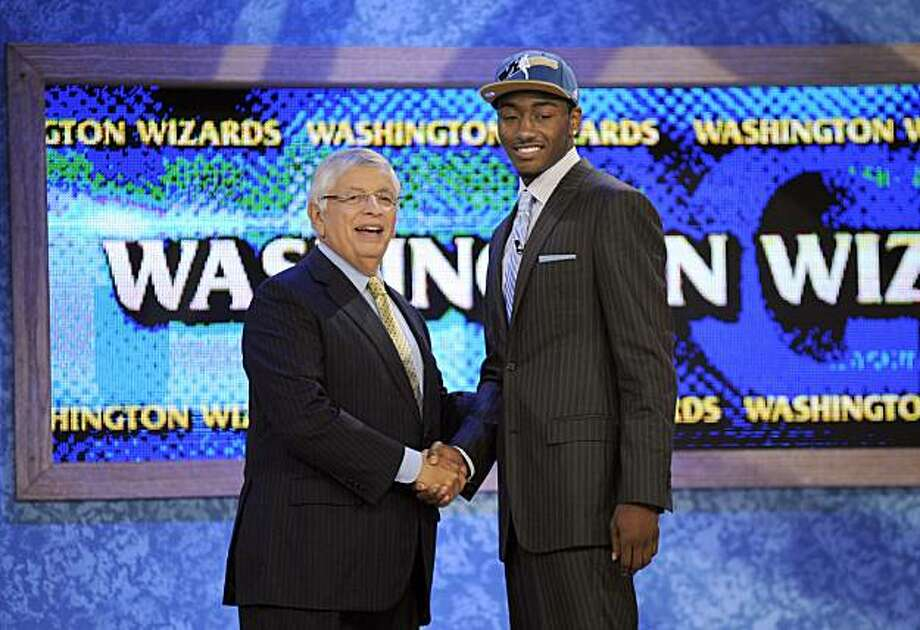 NBA commissioner David Stern, left, poses with the No. 1 overall draft pick John Wall, of Kentucky, who was selected by the Washington Wizards with the No. 1 pick in the NBA basketball draft Thursday, June 24, 2010 in New York. Photo: Bill Kostroun, AP