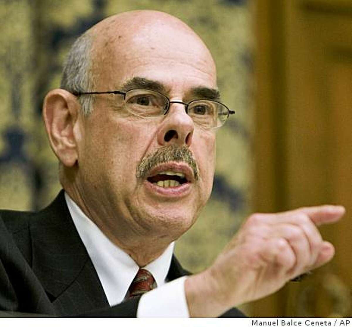 ** FILE ** In this Feb. 26, 2008, file photo, Rep. Henry Waxman, D-Calif., questions witnesses during a hearing on Capitol Hill in Washington. President-elect Obama has said he wants to act quickly on climate change but crucial bipartisan support could erode if Waxman succeeds at unseating Rep. John Dingell, D-Mich., as chairman of the House Energy and Commerce Committee. (AP Photo/Manuel Balce Ceneta, File)