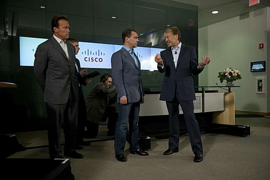 SAN JOSE, CA - JUNE 23:  Russian President Dmitry Medvedev (C) talks with Cisco Chairman and CEO John Chambers (R) and  California Gov. Arnold Schwarzenegger during a demonstration at Cisco headquarters June 23, 2010 in San Jose, California.  During the meeting Cisco Chairman and CEO John Chambers signed a Memorandum of Understanding with President of Renova Group Viktor Vekselberg extending its existing venture commitment to Russia's innovation economy with an incremental US$100 million to the Skolkovo Project. Photo: David Paul Morris, Getty Images