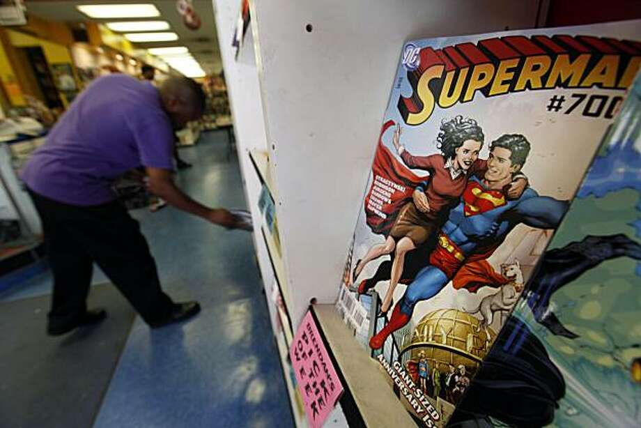 Shown is a copy of the 700th issue of the Superman comic displayed at Fat Jack's Comicrypt in Philadelphia, Wednesday, June 23, 2010. Dan DiDio, DC's co-publisher told The Associated Press on Wednesday The Man of Steel will hoof it across America in future issues as he tries to reconnect with everyday people in a story that will feature actual towns and locations submitted by readers. Photo: Matt Rourke, AP