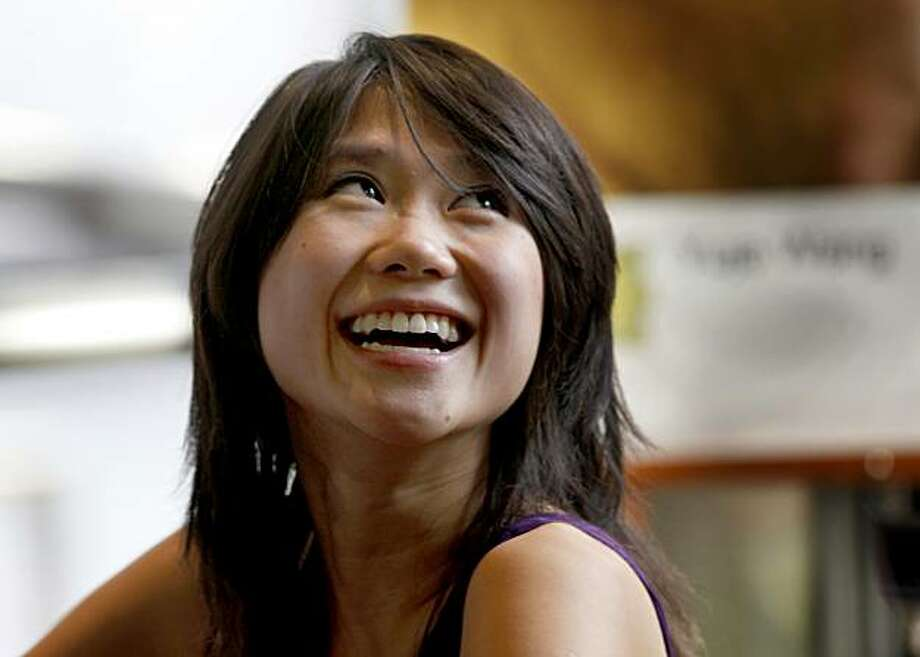 Wang smiled at a request for a photo after signing CD's after her performance. Pianist Yuja Wang played as a soloist with the Shanghai Symphony Sunday November 22, 2009. Chronicle photographer was not allowed to photograph actual performance, Photo: Brant Ward, The Chronicle