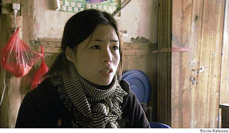 """Nick Broomfield's """"Ghosts,"""" follows the story of Ai Qin Lin, a woman who is smuggled into the UK as a migrant worker in an attempt to save her son from a life of poverty in Fujan, China. The movie opens November 21st at Roxie Cinemas in San Francisco. Photo: Roxie Release"""