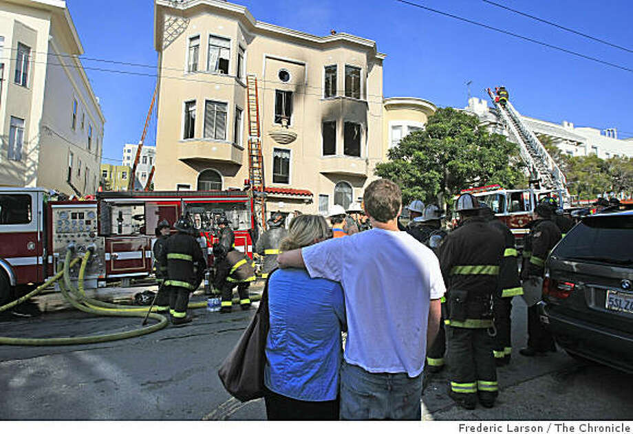 Residents comfort each other at the scene of a two-alarm fire in a three-story apartment building on San Francisco's Russian Hill just before noon on Nov. 18, 2008. The fire killed one person dead and injured another, fire officials said. Photo: Frederic Larson, The Chronicle