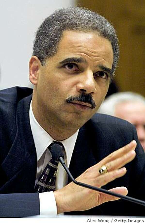 385351 05: (FILE PHOTO) Former deputy attorney general Eric H. Holder Jr. testifies February 8, 2001 before the House Government Reform Committee in Washington DC.  It was reported that former deputy attorney general during the Clinton administration Eric H. Holder Jr. has accepted the position of Attorney General from U.S. President -elect Barack Obama on November 18, 2008.  (Photo by Alex Wong/Newsmakers) Photo: Alex Wong, Getty Images