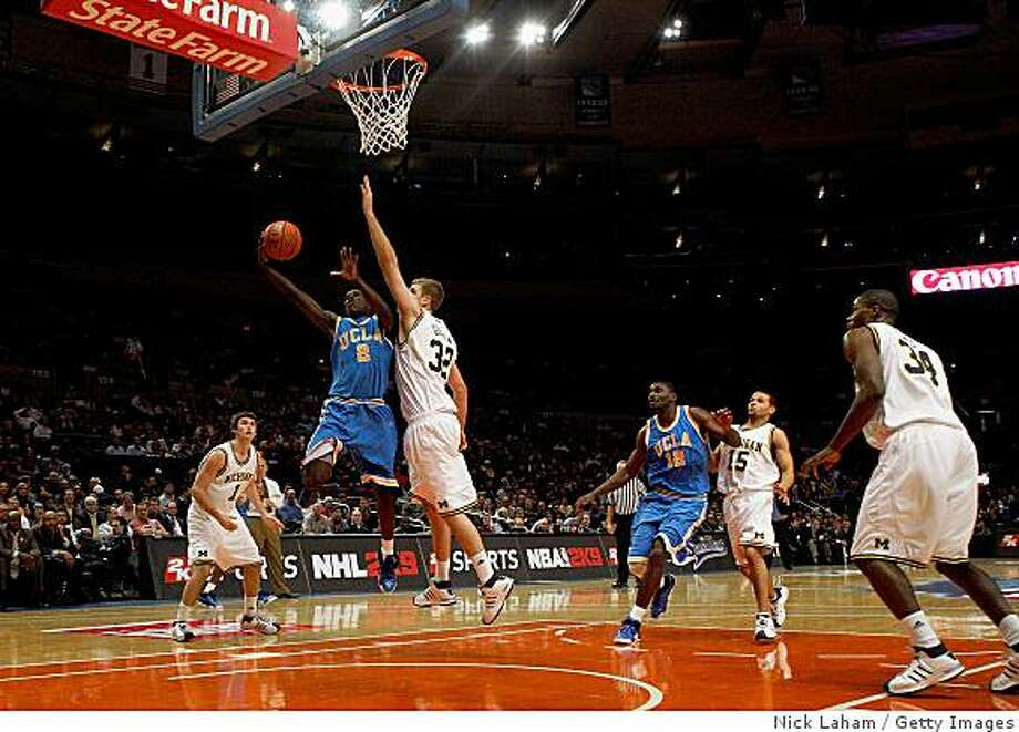 NEW YORK - NOVEMBER 20: Darren Collison #2 of the UCLA Bruins lays the ball up against Zack Gibson #32 of the Michigan Wolverines on November 20, 2008 at Madison Square Garden in New York City.  (Photo by Nick Laham/Getty Images) Photo: Nick Laham, Getty Images