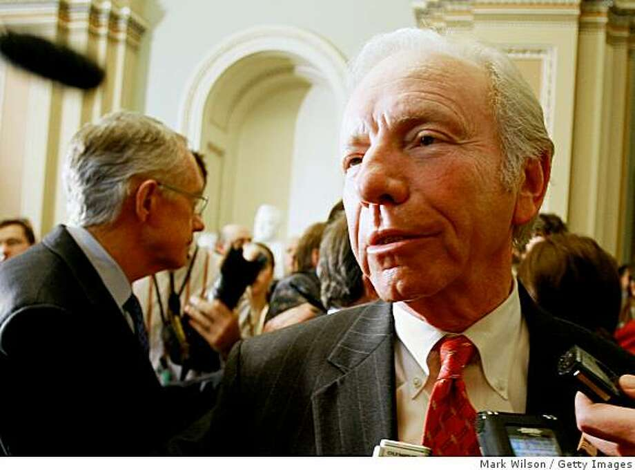 WASHINGTON - NOVEMBER 18:  Sen. Joe Lieberman (I-CT) talks to reporters while flanked by Senate Majority Leader Harry Reid (D-NV)(L) after a closed door meeting at U.S. Capitol November 18, 2008 in Washington, DC. Senate Democrats decided to let Senator Lieberman keep his Homeland Security committee chairmanship despite having backed Republican John McCain for the White House.  (Photo by Mark Wilson/Getty Images) Photo: Mark Wilson, Getty Images