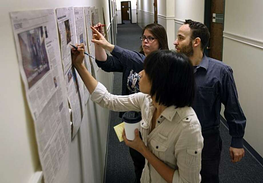 Suzanne Yada, Anne-Marie McReynolds and Michael Stoll edit page proofs in the hallway outside the San Francisco Public Press newsroom in San Francisco, Calif., on Friday, June 18, 2010. The small start-up news operation publishes its first print edition on Tuesday, June 22. Photo: Paul Chinn, The Chronicle