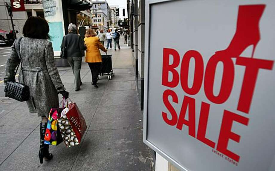 Union Squre shoppers pass Nine West on Stockton Street who is having a boot sale. Squre. November 19, 2008 Photo: Lance Iversen, The Chronicle