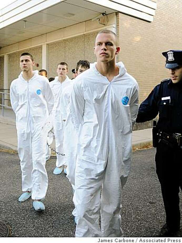 """Jeffrey Conroy, 17, foreground, and other teens arrested in a hate crime murder, are led out of the Fifth Precinct in Patchogue, N.Y., in November 2008 for arraignment on gang assault charges in connection with the death of a 37-year old immigrant. Police said the seven high school students looking """"to beat up some Mexicans"""" attacked the immigrant from Ecuador who worked in a dry cleaners shop. According to police,  Conroy fatally plunged a knife into the man's chest him during the brawl. Photo: James Carbone, Associated Press"""