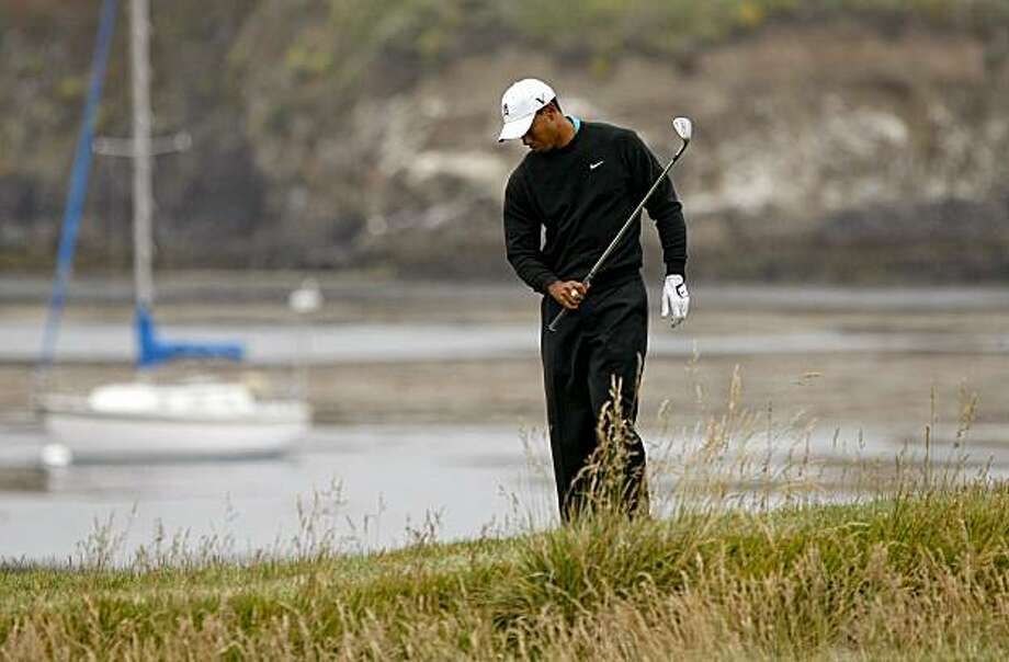 Tiger Woods did not look happy with his chip shot to the par-3 17th hole at the U.S. Open at Pebble Beach on Friday. Photo: Michael Macor, The Chronicle