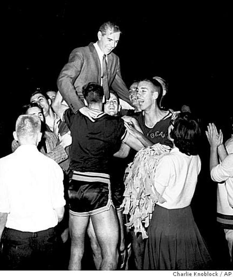 A smiling coach Pete Newell is hoisted to shoulders of members of the California Bears basketball team March 21, 1959 after they won a close, 71-70 decision over West Virginia at Louisville,Ky. to became NCAA champs. Photo: Charlie Knoblock, AP