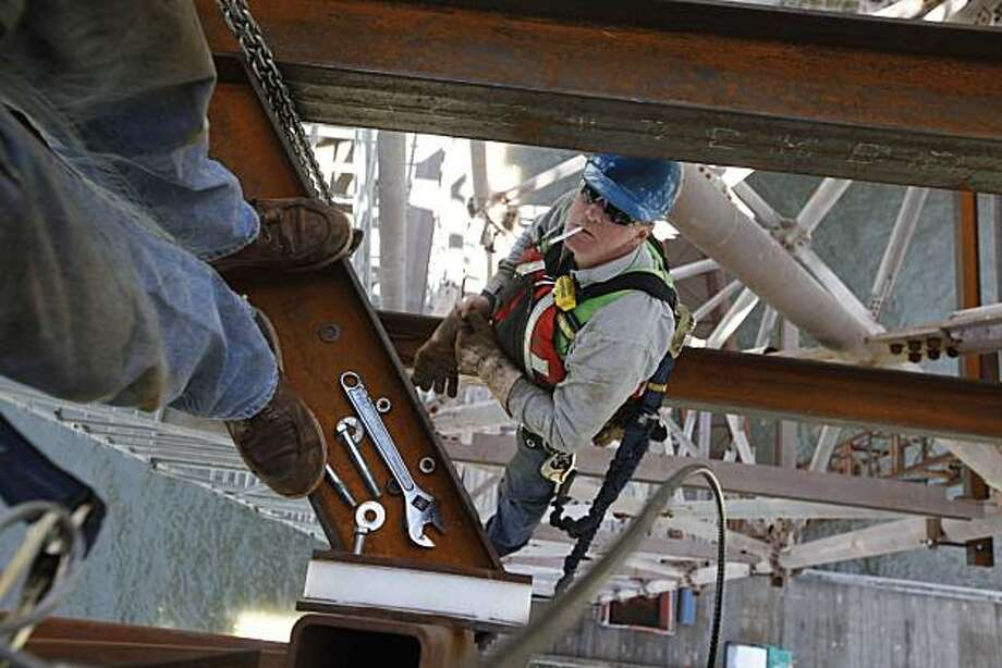 Johnny Calzascia  and Jim Benninghope with American Bridge works to help erect the suspension tower at the construction site of the new Bay Bridge Project on Monday June 14, 2010 in Oakland, Calif. Photo: Mike Kepka, The Chronicle