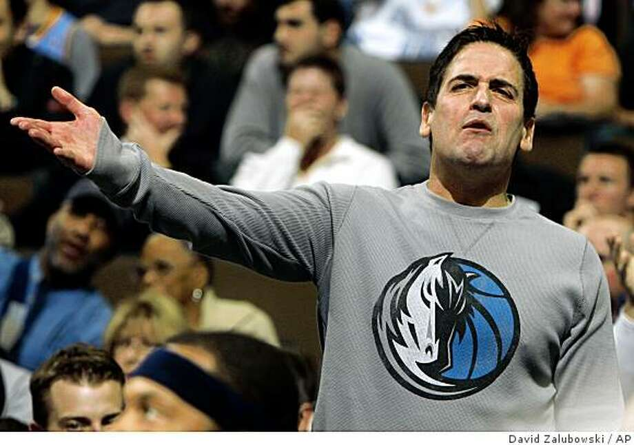 Mark Cuban, the controversial owner of the NBA?s Dallas Mavericks, was charged with insider trading Monday by the SEC. Dallas Mavericks owner Mark Cuban argues a call against his team while facing the Denver Nuggets in the third quarter of the Nuggets' 108-105 victory in an NBA basketball game in Denver on Friday, Nov. 7, 2008. (AP Photo/David Zalubowski) Photo: David Zalubowski, AP