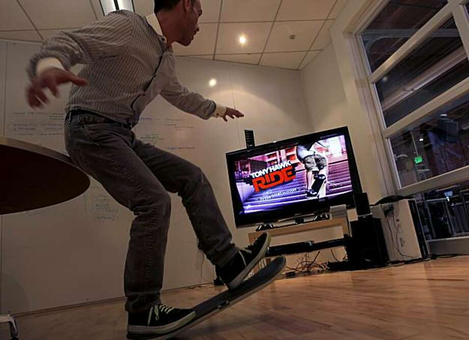 David Rice, chef operating officer of Metacafe, tries out the Tony Hawk video game at the Metacafe , Wednesday June 16, 2010, in San Francisco, Calif. Metacafe is one of the many firms from Silicon Valley that has moved up to San Francisco.David Rice, chef operating officer of Metacafe, tries out the Tony Hawk video game at the Metacafe , Wednesday June 16, 2010, in San Francisco, Calif. Metacafe is one of the many firms from Silicon Valley that has moved up to San Francisco. Photo: Lacy Atkins, The Chronicle