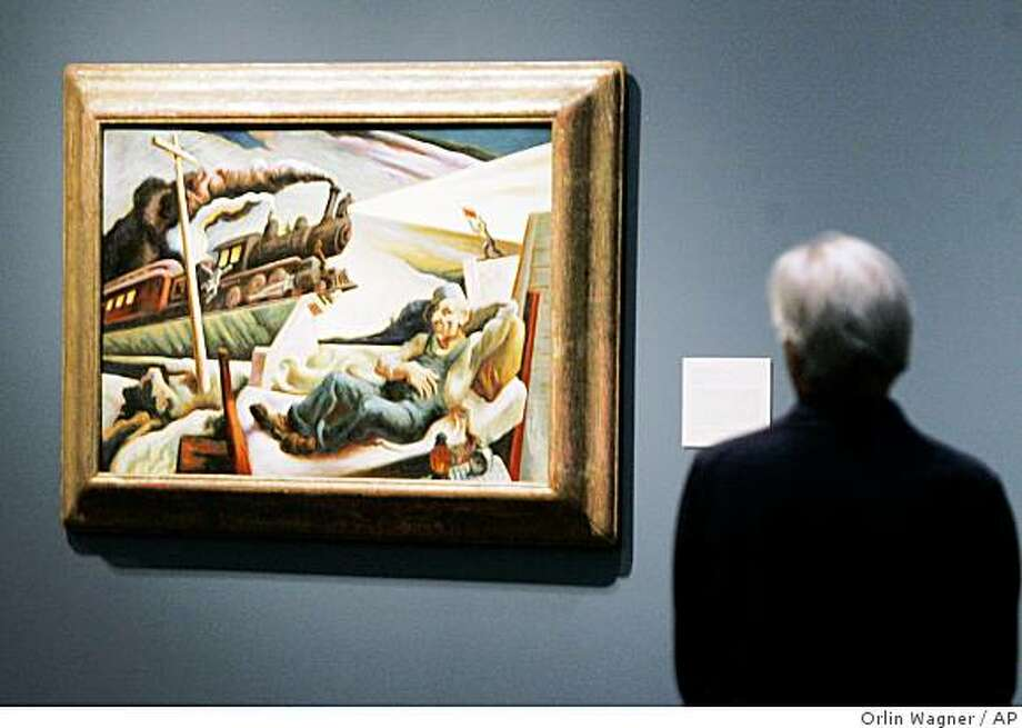 "**APN ADVANCE FOR NOV 23**   A museum patron views ""The Engineers's Dream"" by Thomas Hart Benton at the Nelson Atkins Museum of Art in Kansas City, Mo., Thursday, Oct. 23, 2008. The exhibit, Age of Steam, shows the influence steam power had on the arts. (AP Photo/Orlin Wagner) Photo: Orlin Wagner, AP"
