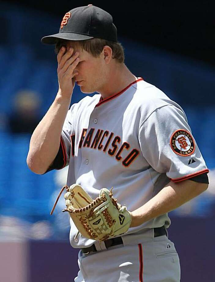 San Francisco Giants pitcher Matt Cain wipes his brow during fifth inning interleague  baseball action against the Toronto Blue Jays in Toronto Saturday, June 19, 2010. Photo: Darren Calabrese, AP