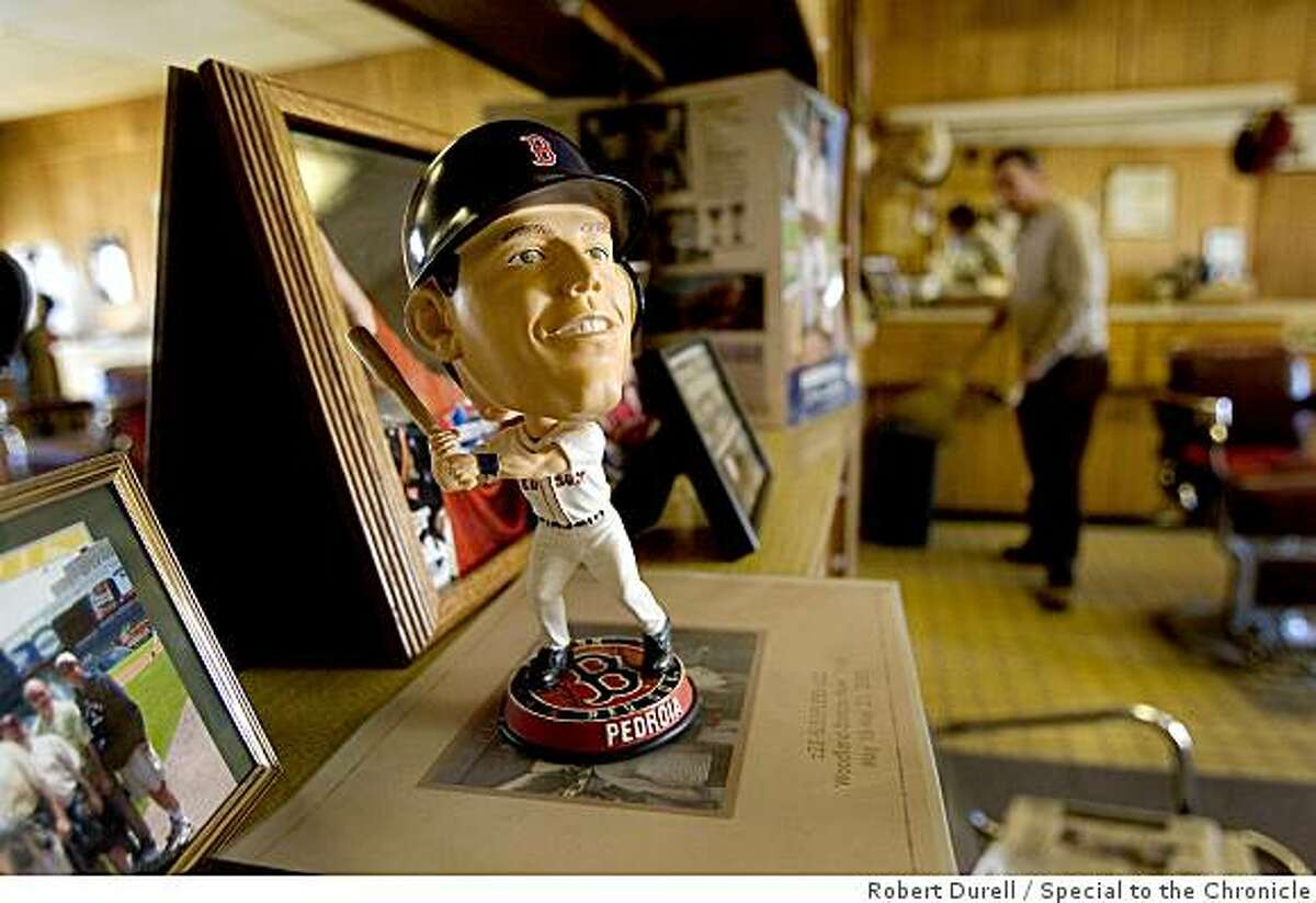 WOODLAND, California-- A bobble head doll sits on the shelf of Top Hat barber shop in Woodland, California November 21, 2008, the place where Dustin Pedroia, 2008 American League MVP, got his haircut while growing up the Yolo County farming town. Stan Giusti, rear owner of Top Hat has been cutting his hair since he was a child.