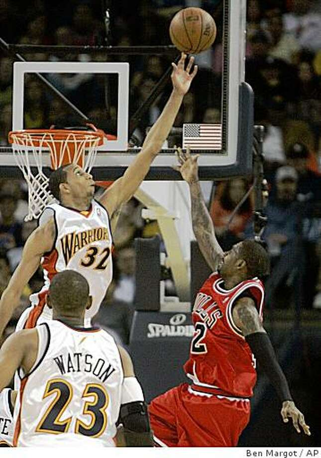 Golden State Warriors' Brandan Wright (32) blocks the shot of Chicago Bulls' Larry Hughes, right, in the first half of an NBA basketball game Friday, Nov. 21, 2008, in Oakland, Calif. (AP Photo/Ben Margot) Photo: Ben Margot, AP