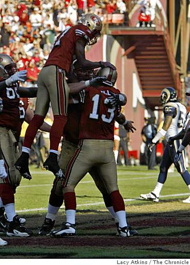 San Francisco 49ers  congratulates quarterback Shaun Hill after he scores in the first half against  the St. Louis Rams, Sunday Nov. 16, 2008, in SanFrancisco , Calif. Photo: Lacy Atkins, The Chronicle