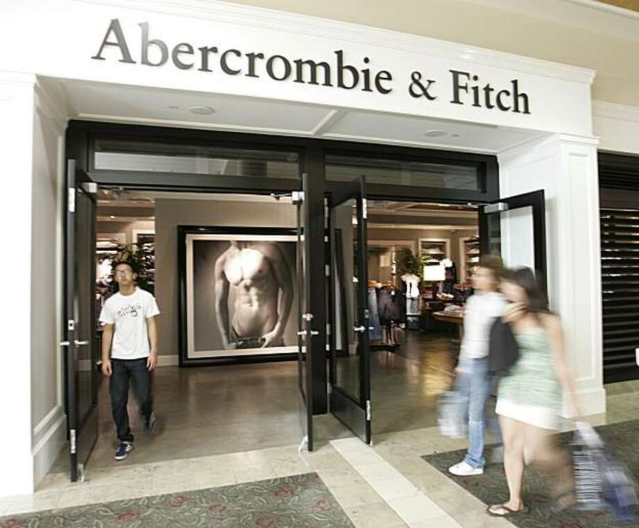 **FILE**  In this Aug. 12, 2008 file photo, shoppers walk in front of a Abercrombie & Fitch store in San Jose, Calif. Teen retailer Abercrombie & Fitch Co. said Thursday, Sept. 4, 2008, its same-store sales in August dropped 11 percent _ a far steeper drop than Wall Street analysts expected. (AP Photo/Paul Sakuma, file) Photo: Paul Sakuma, AP