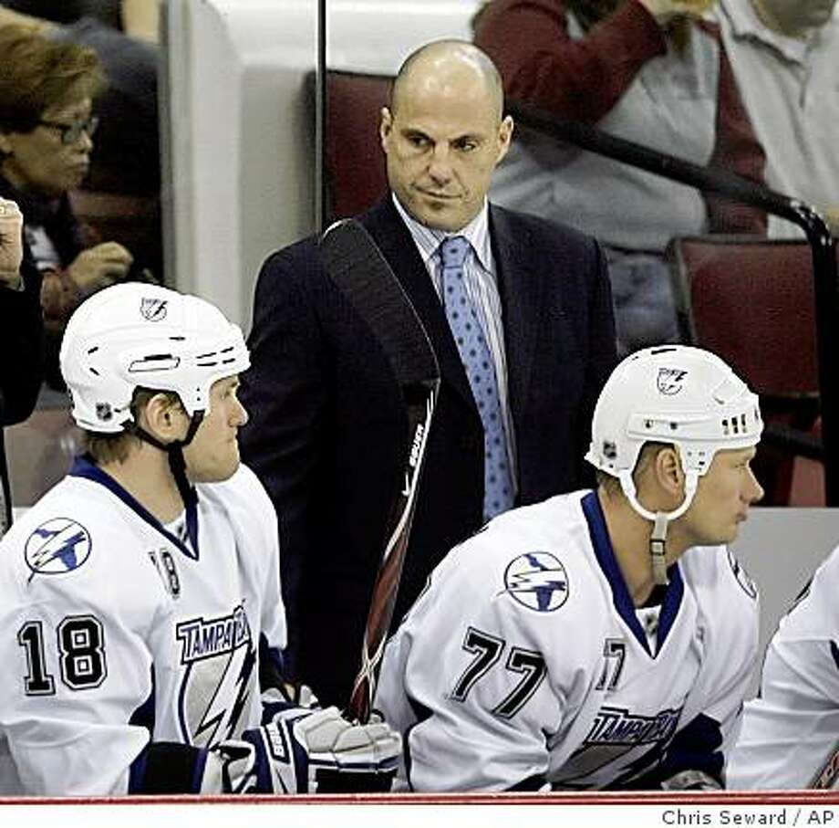 Tampa Bay Lightning head coach Rick Tocchet stands behind Lightning's Adam Hall (18) and Chris Gratton (77) during the first period against the Carolina Hurricanes in Raleigh, N.C., Sunday, Nov. 16, 2008. Photo: Chris Seward, AP