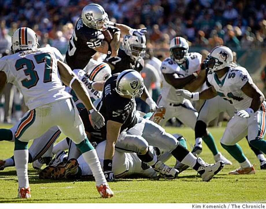 Justin Fargas is stopped near the goal line as the Raiders continue their scoreless offense streak on Sunday, Nov. 16, 2008 as the Miami Dolphins beat the Oakland Raiders 15-17 at Dolphins Stadium in Miami, Fla. Photo: Kim Komenich, The Chronicle