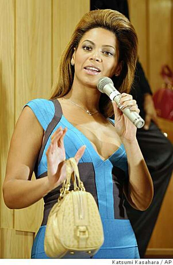 Beyonce speaks during an opening event of a boutique in Tokyo's Ginza shopping district Friday, Oct. 31, 2008. Beyonce is listed as a promotional model for the Japanese bag maker. Photo: Katsumi Kasahara, AP