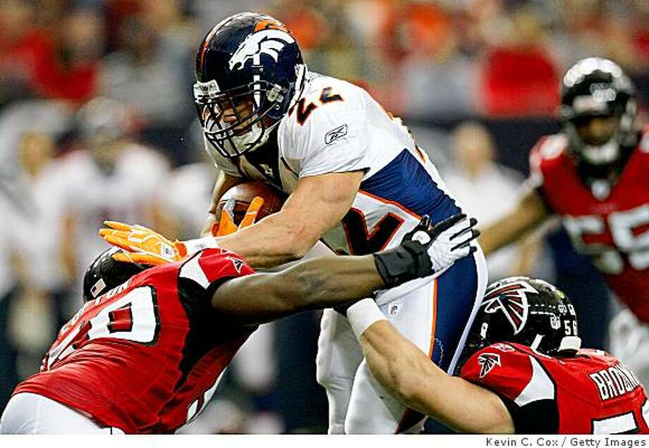 Broncos fullback Peyton Hillis drives into Curtis Lofton and Keith Brooking #56 of the Atlanta Falcons during a game at the Georgia Dome on November 16, 2008 in Atlanta. Photo: Kevin C. Cox, Getty Images